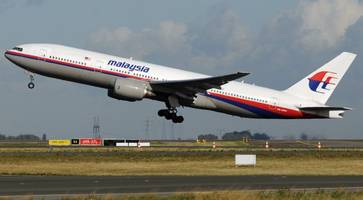 Missing Malaysia Airlines jet hundreds of miles off course