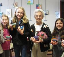 residents at the solana willistown help girl scouts earn badge